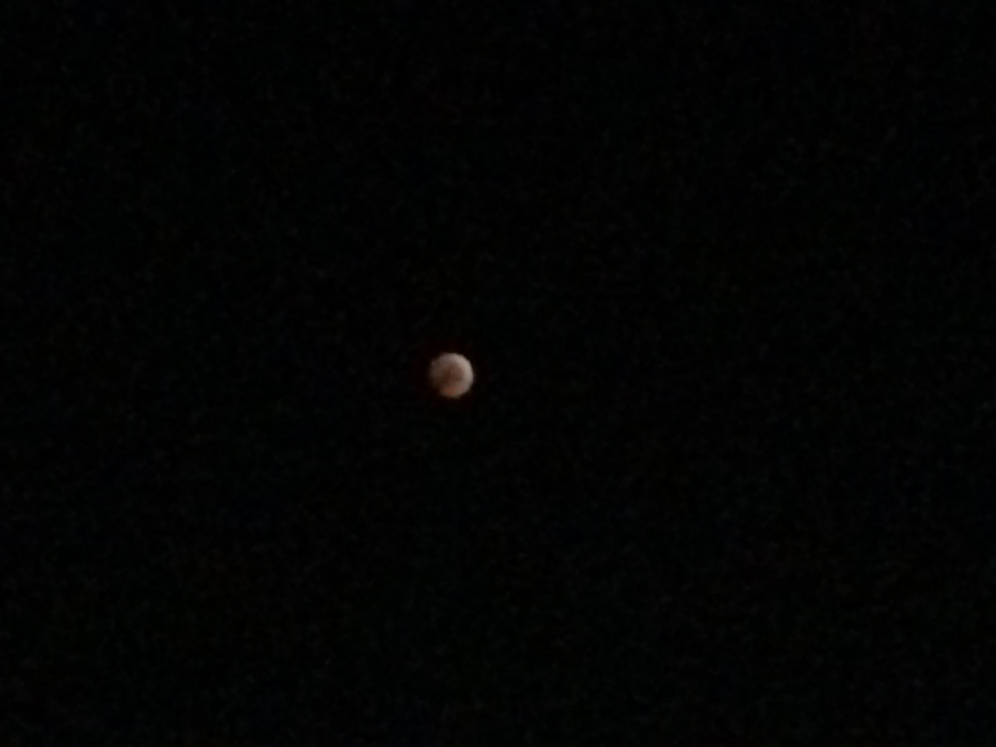 Full lunar eclipse - moon in earth's blood red shadow